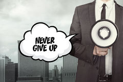 Never give up text on speech bubble with businessman Royalty Free Stock Photography