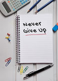 Never give up word on notebook Stock Photos
