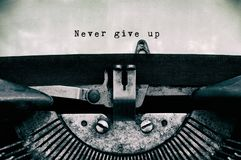 Never give up words typed on a vintage typewriter