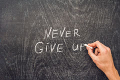 Never give up words written on the chalkboard Royalty Free Stock Photography