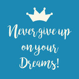 Never give up on your dreams inspirational quote card. Cute blue motivation card with a Never give up on your dreams inspirational quote and a crown symbol Royalty Free Stock Photo
