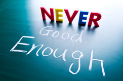 Never good enough concept Stock Image
