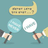 Never have you ever questions - Man and woman hands holding paddle sticks Royalty Free Stock Photography