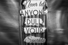 Never let anyone dull your sparkle-phrase. Letterpress, concept, business, sign, type, word, wood, typography, vintage, text, font, illustration, white, isolated royalty free stock images