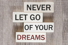 Never let go of your dreams motivational message stock image