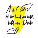 Never let the hand you hold, hold you down - feministic inspire motivational quote. Hand drawn beautiful lettering. stock images