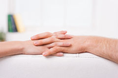 Never let you go. Close-up of man and woman holding hands Royalty Free Stock Photos