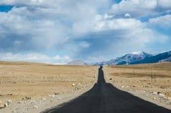 Never look Back. This road goes from Leh to Kargil crossing the word's ancient Lamayauru Monastery Stock Photos