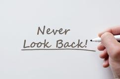 Never look back written on whiteboard Stock Image