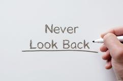 Never look back written on whiteboard Stock Photo
