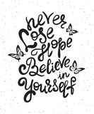 Never lose hope and believe in yourself. Handwritten design element with butterflies. Hand drawn lettering quote on white background  for motivation and Stock Image