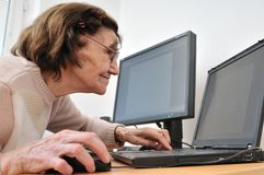 Never old enough - senior woman with computer Royalty Free Stock Image
