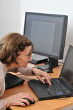 Never old enough - senior woman with computer Stock Images