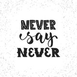 Never say never - hand drawn lettering phrase isolated on the white grunge background. Fun brush ink inscription for. Photo overlays, greeting card or t-shirt Stock Images