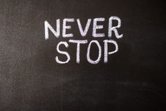 Never stop, business or school motivational words. Stock Images