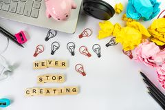 Never stop creating word on wooden block, creative idea concept royalty free stock photography