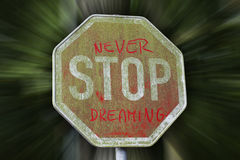 Never stop dreaming message on traffic sign Royalty Free Stock Images