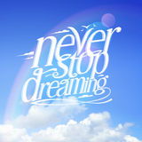 Never stop dreaming quote vector card against blue sky Stock Images