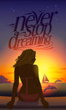 Never stop dreaming romantic quote card with young beautiful woman silhouette at sunset sitting on a tropical beach Royalty Free Stock Photo
