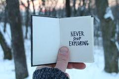 Never stop exploring. Inspirational and motivational quotes. . Book and text. stock image