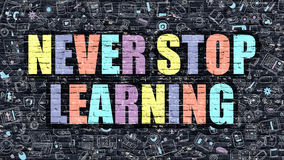 Never Stop Learning Concept with Doodle Design Icons. Royalty Free Stock Photo