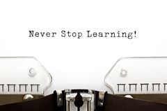 Never Stop Learning Typewriter royalty free stock photography