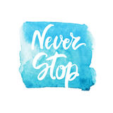 Never stop lettering on watercolor turquoise stain. Vector inspiration and motivation phrase. stock photo