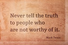 Never tell Twain. Never tell the truth to people who are not worthy of it - famous American writer Mark Twain quote printed on vintage grunge paper Stock Images