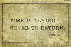 Never to return Virgil. Time is flying never to return - ancient Roman poet Virgil quote printed on grunge vintage cardboard royalty free stock image