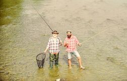 Never Too Far For Family. summer weekend. mature men fisher. male friendship. family bonding. father and son fishing