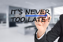 It is never too late text with businesswoman hand writing on transparent background. It is never too late text with businesswoman writing on transparent Royalty Free Stock Photos