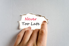 Never too late text concept. Isolated over white background Stock Image