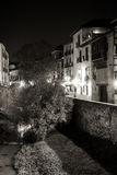Neverending lights. Urban scene of a river crossing the old part of the city of Granada, Spain, taken at night Royalty Free Stock Photography