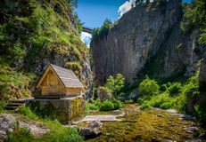 Nevidio canyon in Montenegro. Nevidio canyon. Rock cliff, river, bridge and small wooden house.  Invisible canyon, popular touristic attraction of Montenegro Royalty Free Stock Photo