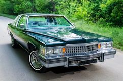 NEVINOMYSSC, RUSSIA - MAY 13, 2016: Automobiles. Offsite photography of old American cars. Cadillac DeVille D`Elegance. 1978s. View of Machine type from the Stock Image