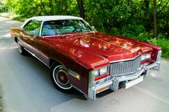 NEVINOMYSSC, RUSSIA - MAY 13, 2016: Automobiles. Offsite photography of old American cars. Cadillac Eldorado Convertible. 1976s. View of Machine type from the Royalty Free Stock Photo