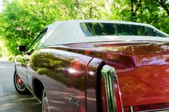 NEVINOMYSSC, RUSSIA - MAY 13, 2016: Automobiles. Offsite photography of old American cars. Cadillac Eldorado Convertible. 1976s. View of Rear view of machine on Stock Photography