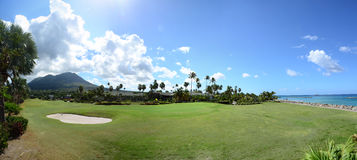 Nevis Peak in the Background of the Golf Course. Green grass with sand trap Stock Photo