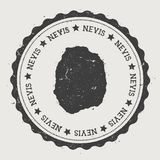 Nevis sticker. Hipster round rubber stamp with island map. Vintage passport sign with circular text and stars, vector illustration Stock Photos