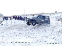 Nevyansk, Russia, 23 February 2018, Open winter off-road racing. The SUV flies over a snowy hill royalty free stock photo