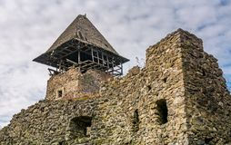 Tower and wall of Nevytsky Castle. Nevytsky Castle, Ukraine - October 27, 2016: tower with wooden roof and stone wall of mighty Nevytsky Castle. popular travel Stock Photography