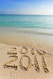 New 2011. The wave washes off an inscription 2010. Royalty Free Stock Images