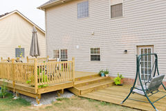 New above ground deck and patio of family home Stock Photos