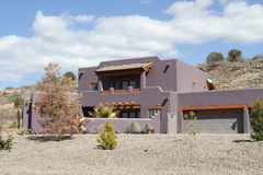 USA, Arizona: New Adobe House in a Desert. This remarkable new Pueblo Rivival-style adobe house is located near Montezuma Lake in Arizona. The term adobe has Stock Photo