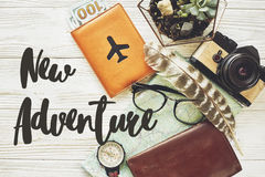 New adventure text sign concept. say yes to new adventures, flat. Lay. map passport money compass and glasses photo camera on white wooden background top view stock photos