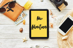 New adventure text sign concept on yellow tablet screen. say yes Royalty Free Stock Images