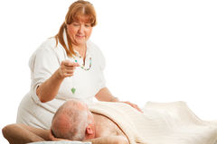 New Age Gem Healing. New age healer using a jade pendulum to unblock her patient's energy centers Stock Photo