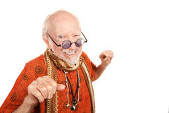 New Age Man Throwing a Punch. Funny senior new age man throwing a punch Royalty Free Stock Photography