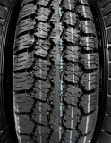 New all weather tire treads and sipes macro shot stock photo Royalty Free Stock Photos