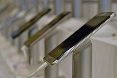 Close up of Android Phones on display in a mobile phone shop. A New Android Phone is on display and the photo is taken at a close distance using a macro lens to Royalty Free Stock Photo